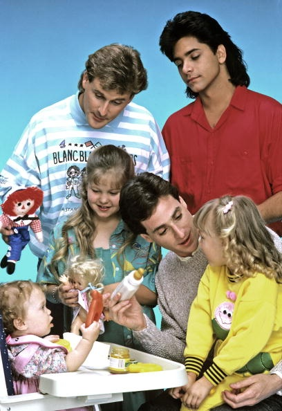 Full House - 'Our Very First Show' - Pilot - Season 1 -  9/22/87, Bob Saget (bottom right) played widower Danny Tanner, the father of three girls, from left: Michelle (played by twins Mary Kate/Ashley Olsen), D.J. (Candace Cameron) and Stephanie (Jodie Sweetin), who had his friend, Joey Gladstone (Dave Coulier, left) and the girls' Uncle Jesse (John Stamos) move in to help raise them