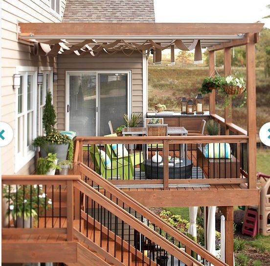 Deck with stairs to patio below (wrought iron spindles)  This <3