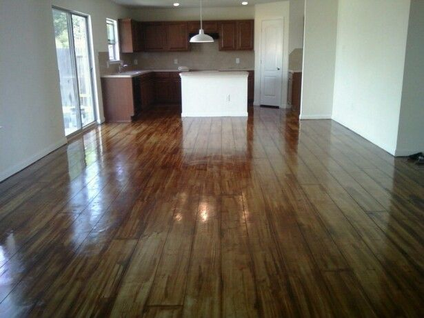 Concrete floors stained to look like wood floors.