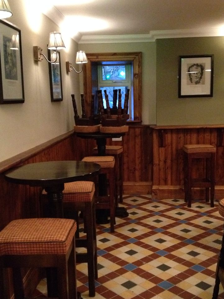 We fitted a traditional pine wall paneling detail for the snug