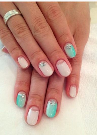 turquoise and nude half moon nails