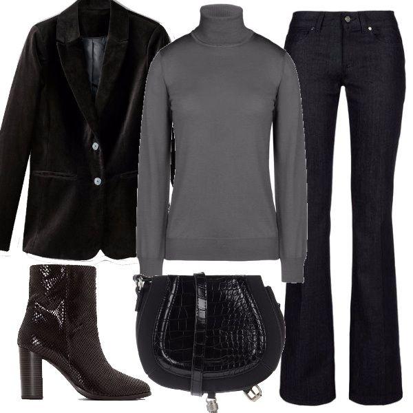 Outfit che richiama i telefilm americani, jeans a zampa, dolcevita e giacca di velluto, arricchito dai boots effetto rettile e dalla tracolla con particolari cocco e pendente.