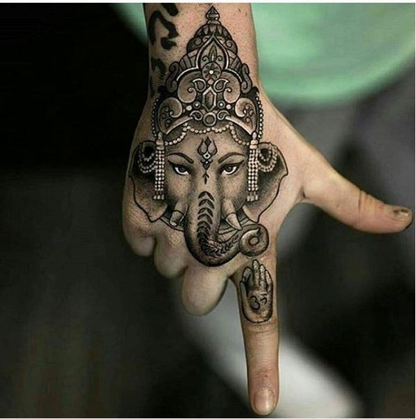 23. Indian lucky charm on the hand This distinctive piece of art on the hand shows an ornate elephant with a traditional Indian sign on its forehead, the icon of a hand on the forefinger is an amusing detail. The tattooing is about a true sense of mindfulness. - source