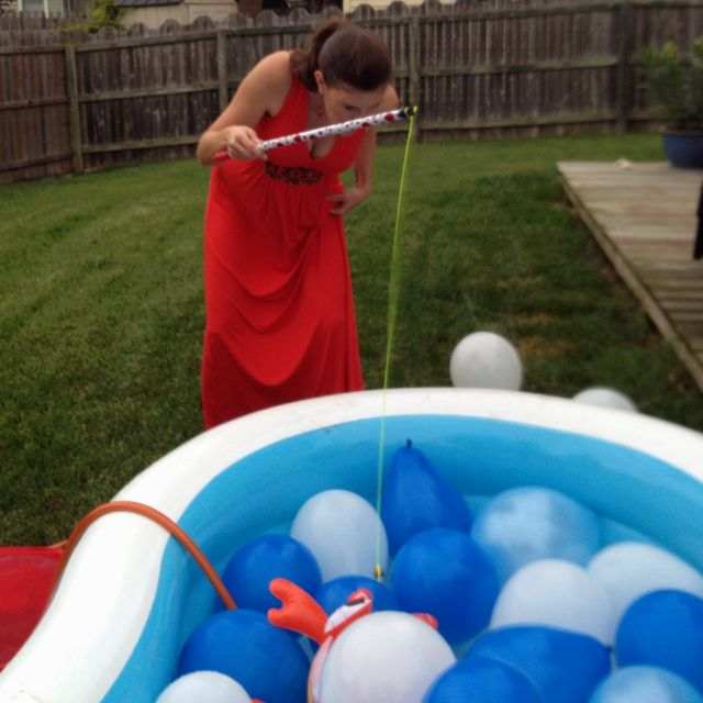 Fishing for pacifiers baby shower game -- will need: 10 pacifiers, 10 paper clips, a fishing pole with line (or a stick & a string), a magnet (one that can be tied or clipped to the end of the string/line), a kiddie pool filled about an inch with water and enough balloons to cover the pool surface.  Affix one paper clip to each pacifier and toss them in the water under the balloons.  Taking turns, each person has one minute to fish out as many pacifiers as possible.  Person with the most…