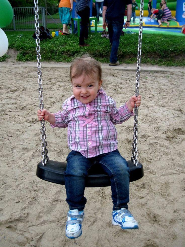 Olivia having fun swinging.
