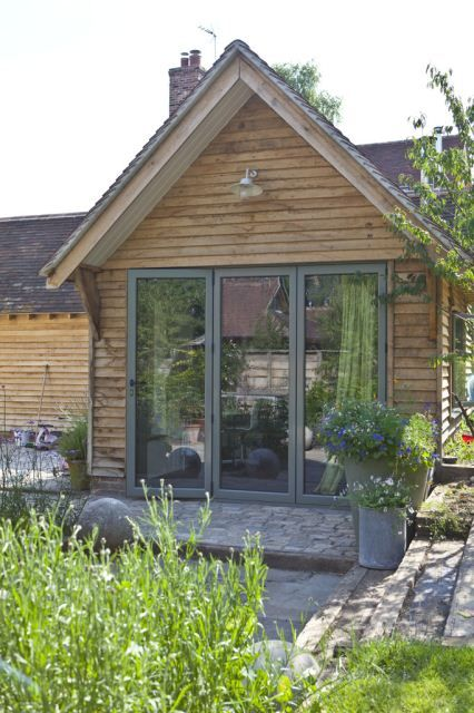 Bi-fold doors on a home office to complement the nearby conservatory
