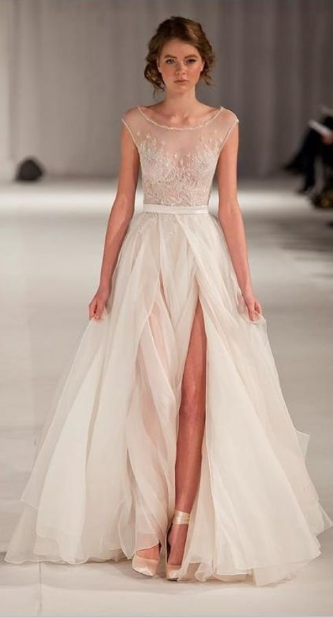 Not exactly what I want, but the sheer look is beautiful. Not 100% on that long slit... -repinned from Los Angeles County & Orange County wedding minister https://OfficiantGuy.com