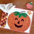 Place Mat pattern:  Pieced and appliqued pumpkin is easy to make. Napkin forms the husk of the Indian corn pocket. Find the PDF pattern for download at www.craftsy.com