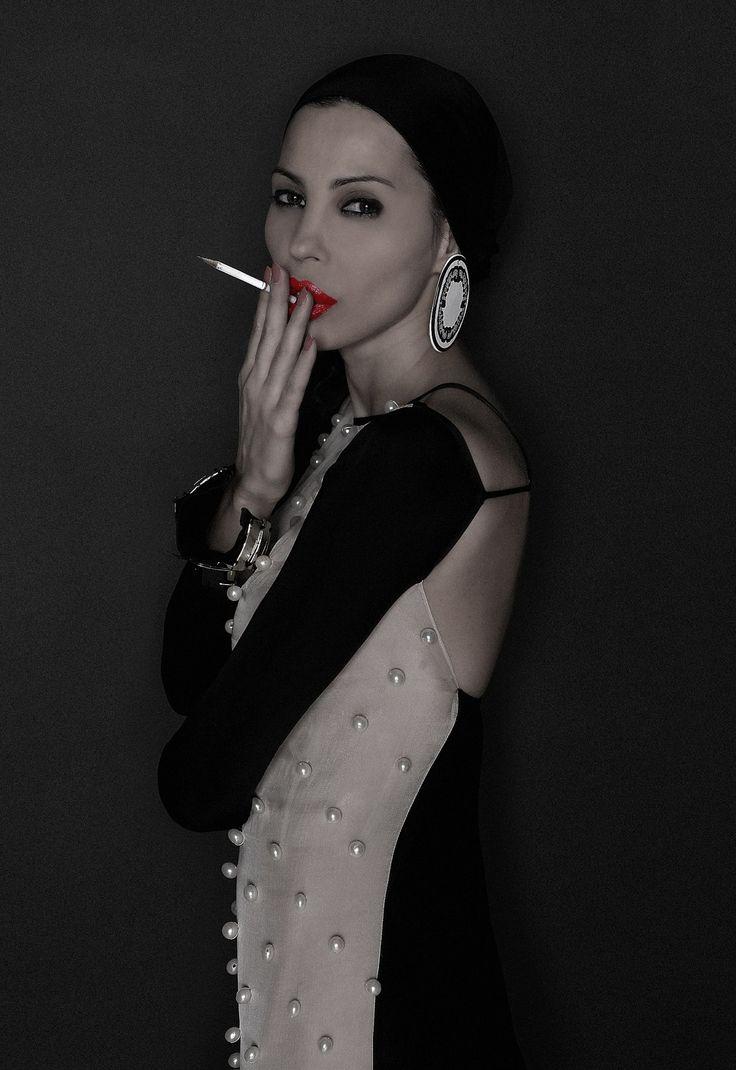 Ingrid  Vlasov,smoking a pencil,dress,fashion,pearls