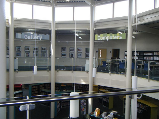 suspended sign in atrium by Opening the Book, via Flickr