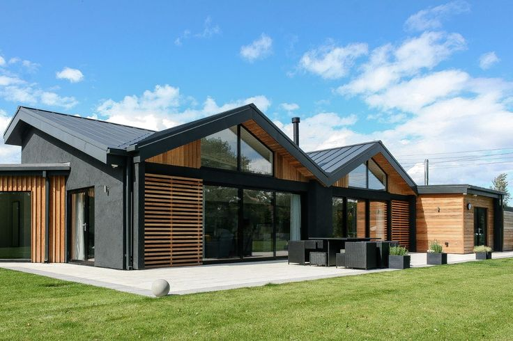 Contemporary Disability Bungalow In Harrogate with cedar cladding and dark grey through colour render.