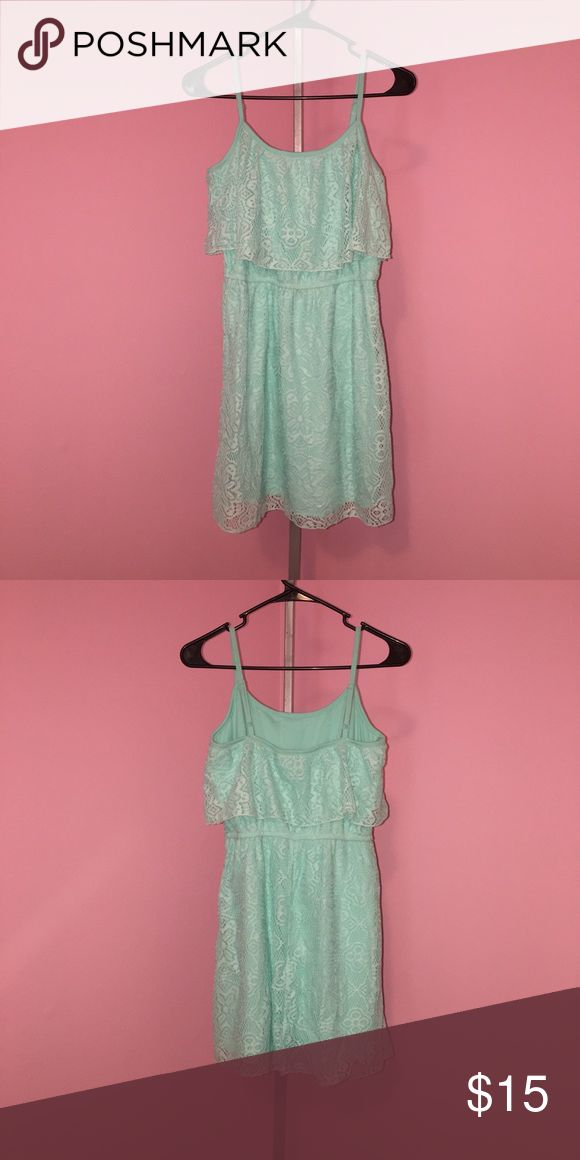 Mint Colored Lace Dress Size M Size Medium Lace Spaghetti Strap Mint Colored Dress in Excellent Condition... looks super cute with strappy sandals or a blue jean jacket and boots! Dresses