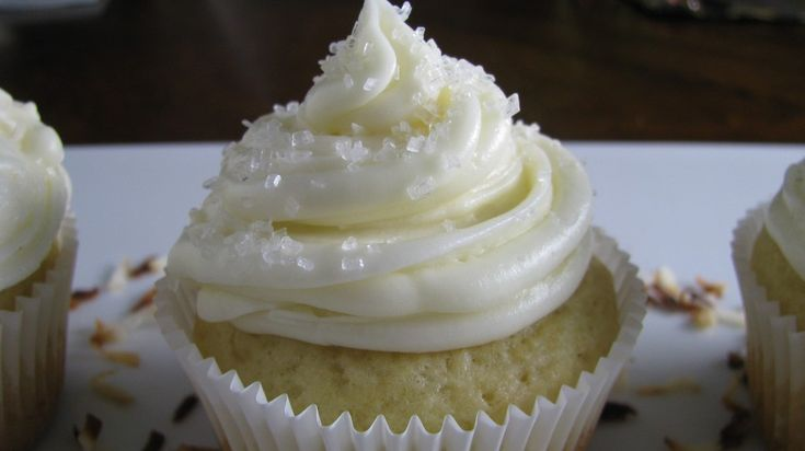 Coconut Rum Cupcakes...I think this icing would be a great addition to my coconut cupcakes.