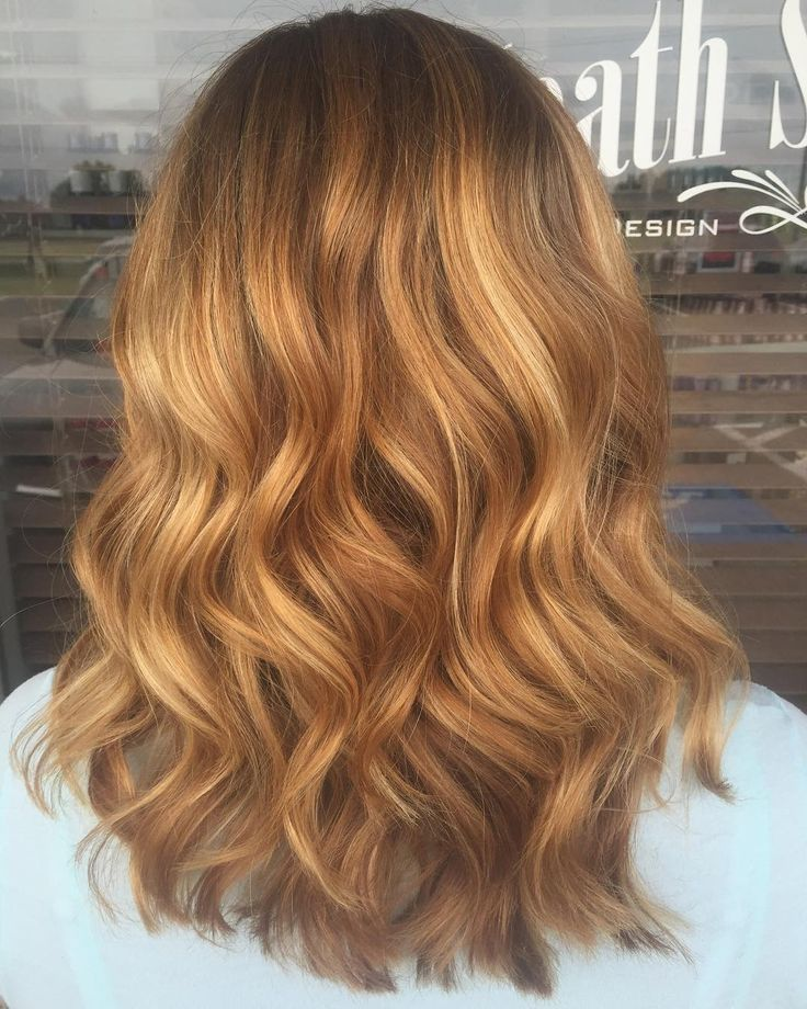 Wavy Strawberry Blonde Hair With Some Blonde Balayage