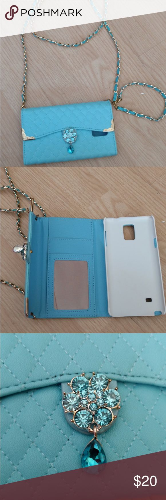 Phone case. Wallet phone case for a Samsung Galaxy Note 4.  Brand new never used.  I cut tags off, but never put phone in it.  Ended up switching phones.  Color is a turquoise. Accessories Phone Cases