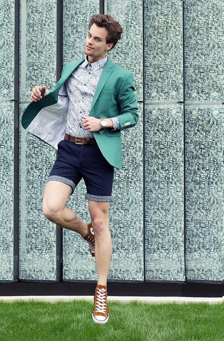Shop this look on Lookastic:  https://lookastic.com/men/looks/blazer-dress-shirt-shorts-high-top-sneakers-belt-watch/12044  — Grey Paisley Dress Shirt  — Teal Blazer  — Tan Leather Watch  — Dark Brown Leather Belt  — Navy Shorts  — Tobacco High Top Sneakers