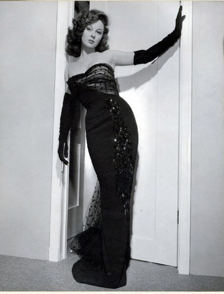long black gloves and a fancy dress- Susan Hayward