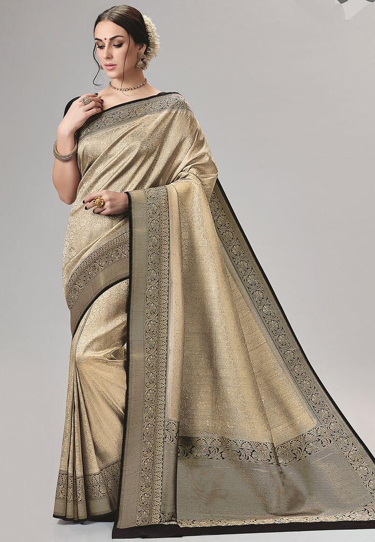 Art Bangalore Silk Saree in Beige Beautifully woven with Zari Available with an Unstitched Art Silk Blouse in Black Free Services: Fall and Edging (Pico) Do note: Accessories shown in the image are for presentation purposes only.(Slight variation in actual color vs. image is possible.)