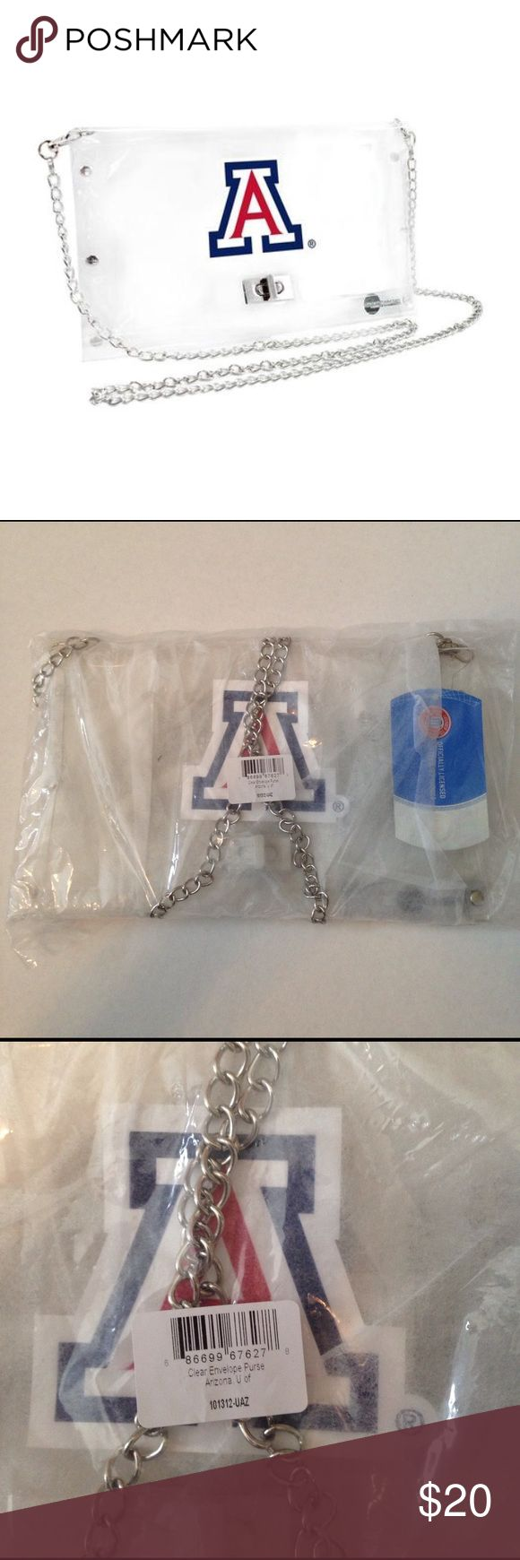 """U. of Arizona Wildcats NCAA Clear Envelope Purse Clear purse with shoulder chain - approved for use in NFL/NCAA Stadiums. Perfect for game day! Still wrapped in original sealed plastic. Officially licensed collegiate product. 10"""" x 6"""" University of Arizona Bags Shoulder Bags"""
