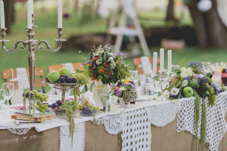The main table, main colours are plum and green. Look at the little touches such as a tea cup holding lovely flowers.