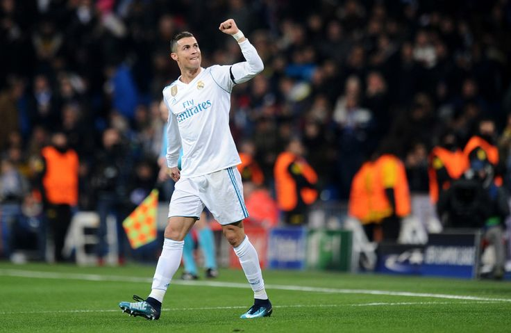 Cristiano Ronaldo Photos - Cristiano Ronaldo of Real Madrid celebrates after scoring his sides second goal during the UEFA Champions League group H match between Real Madrid and Borussia Dortmund at Estadio Santiago Bernabeu on December 6, 2017 in Madrid, Spain.  (Photo by Denis Doyle/Getty Images) <i></i>* Local Caption <i></i>* Heung-Min Son - Real Madrid v Borussia Dortmund - UEFA Champions League