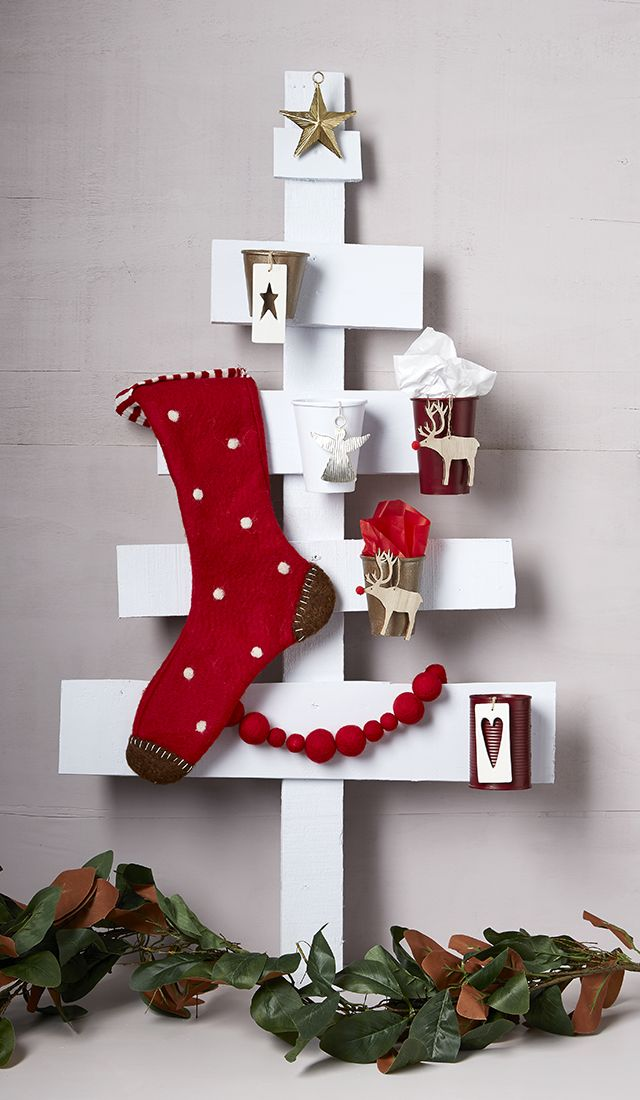 Scandi-inspired Christmas tree made out of old pallet wood. Great DIY for the family.
