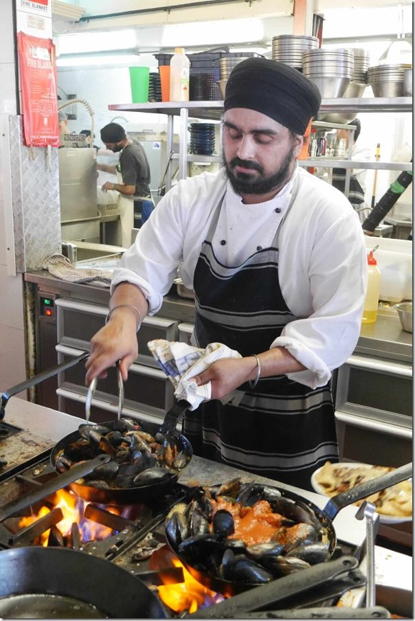 Chef preparing chilli tomato mussels, Little Creatures Fremantle Brewery