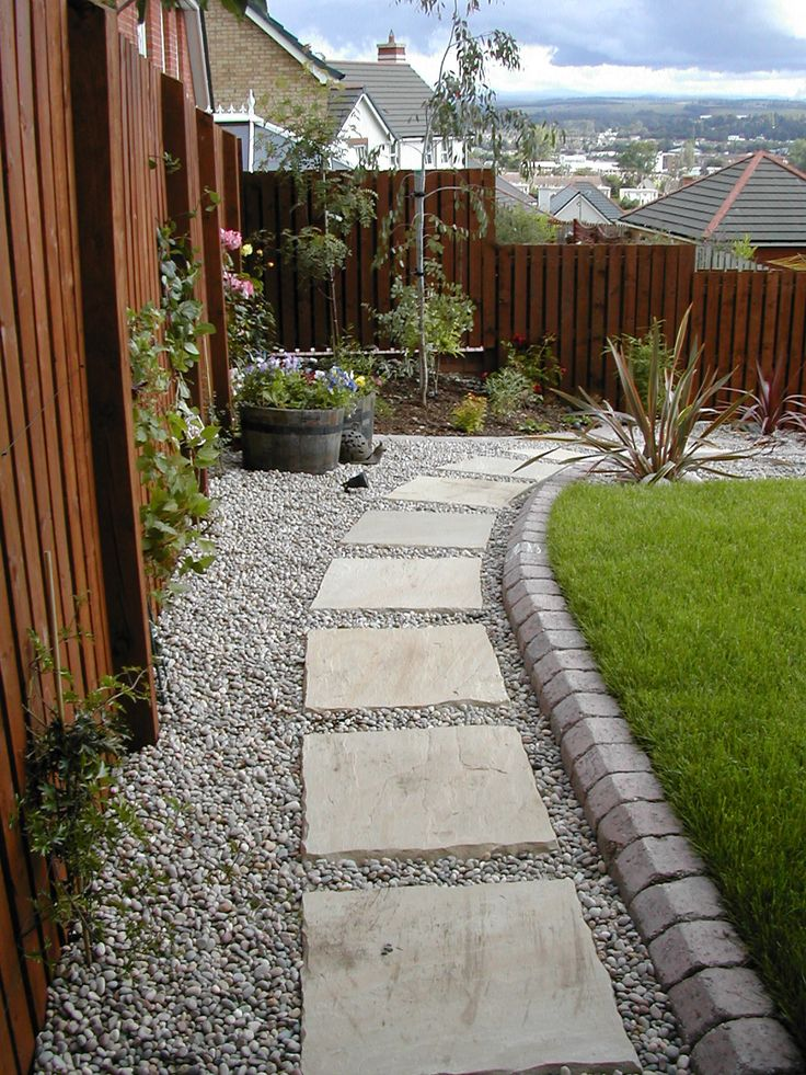 Thistlethwaite stepping stone path with beach pebbles and a tegula kerb edge.