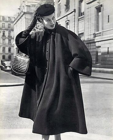 Model is wearing Balenciaga's wool winter coat inspired by the clergy, photo by Philippe Pottier, 1951