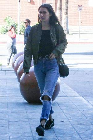 Bella Hadid wearing Alexander Wang Rockie Bag and Puma Suede Sneakers