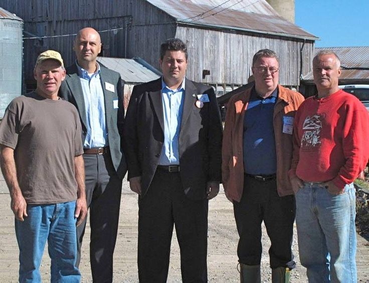 After touring the lands, The big pink bus and van with MPs stopped at the Tapscott Farm. L-R: Ron Tapscott; Matthew Kellway, MP for Beaches–East York, Critic for Urban Affairs; Dan Harris, MP for Scarborough Southwest, Critic for Post-Secondary Education; Malcolm Allen, MP for Welland, Critic for Agriculture and Agri-Food; Keith Tapscott.