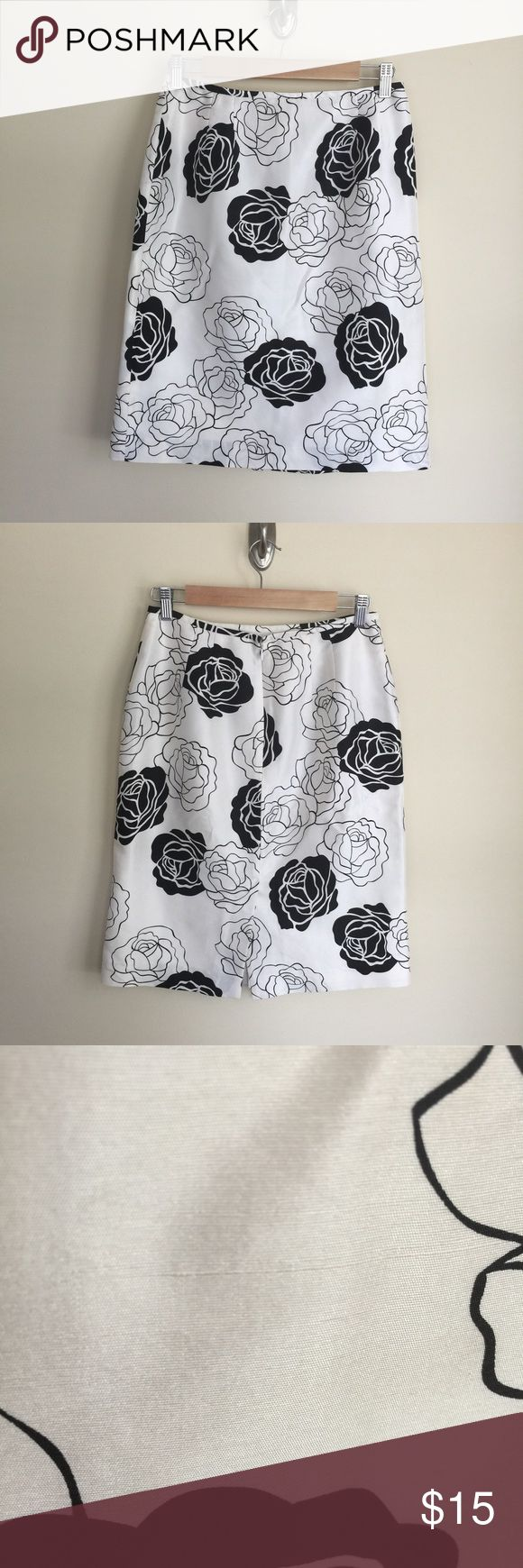 "Dress Barn black and white floral silk skirt sz 6 Dress Barn black and white floral silk skirt, size 6. Tailored style, fully lined, rear zip and hook closure, rear kick slot.  Silk has natural texture (photo 3). Condition:  very good pre-loved. Flaw: some pulling at rear and side seams (photo 4). Material:  shell 100% silk, lining 100% polyester. Measurements (approximate, taken laying flat):  length 23"", flat waist 14"", flat hip 20"", kick slit 7.5 Dress Barn Skirts Midi"