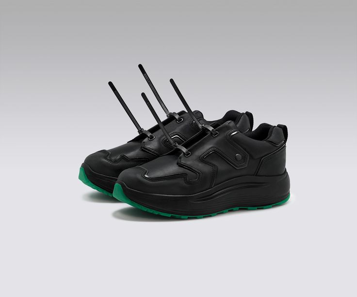 Limited edition sneaker made in collaboration with Sad Boys. All black nubuck and leather low-tops with green sole details and releasable cable-tie laces.