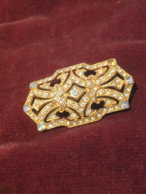 Beautiful vintage pin.  No rhinestones missing.   More information given on my website http://barbspencerdolls.com If you are overcharged on shipping costs, I make refunds.  $12.99