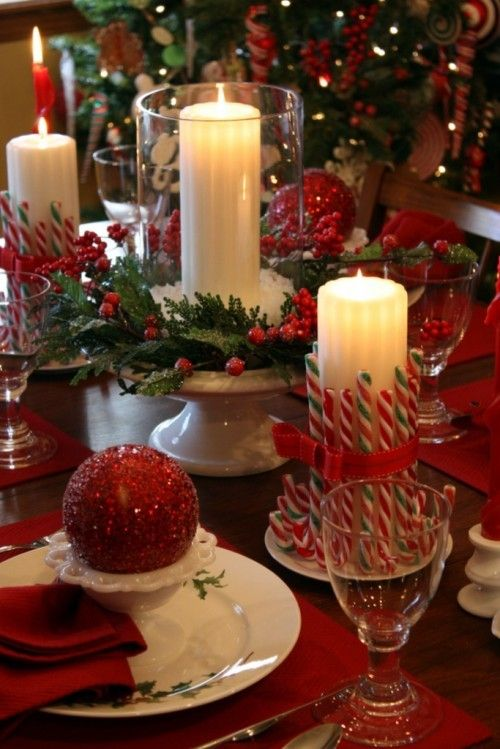 fun and simple Christmas dinner centerpieces - the candy canes around the candles with the ribbon are cute!