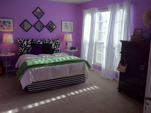 Colorful Teen Bedroom , White curtains and bedding tone down the purple walls. Light and airy nightstands help balance out the black dresser. Pops of color add interest. , Come visit me and other rooms I have decorated at my blog: penniesadaydecora... , Bedrooms Design