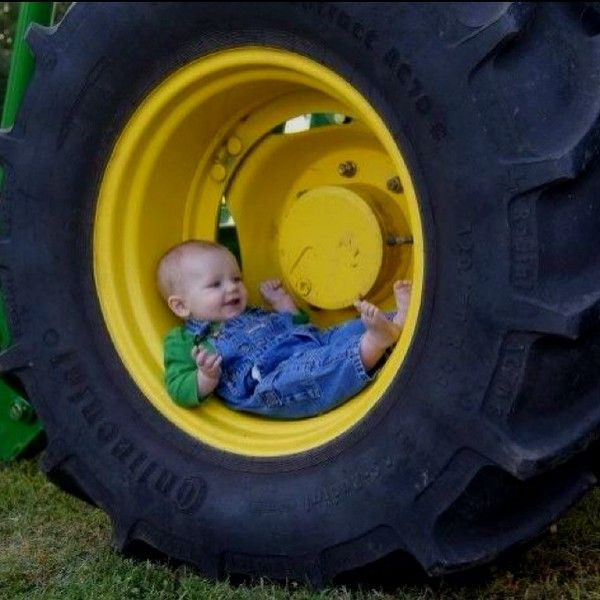 OMG...I LOVE THIS IMAGE! I would SO love to get one of my grandson (Liam) on the farm like this.