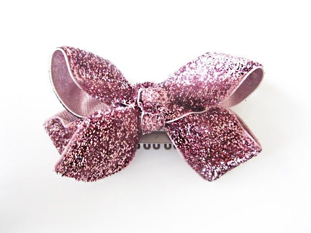 Glittery velvet boutique bow sewn securely to a large latch clip. The Large wisp clip has its combs set farther apart than the little Baby Wisp mini latch clip so extremely fine hair will slip through. This bow is approximately 8 cm across. It has a knotted center and is made of high quality glitter velvet 7/8 ribbon. Our large latch clips are lead, cadmium and mercury free and come with a water repellent coating. We stitch our embellishments to our special clips. #babyheadbands