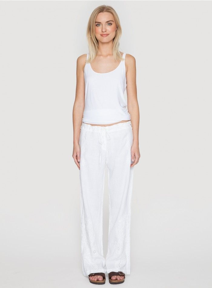Vomera Pant Add the Johnny Was VOMERA PANT to your wardrobe! These wide-leg white linen pants are cut for a relaxed fit and feature a unique tonal embroidery detail along the hem. Pair with a printed blouse, jeweled sandals, and a wide-brimmed hat for a St Tropez-inspired look!  - White Linen - Drawstring Waist with Tie, Four Pockets, Wide Legs - Signature Embroidery - Care Instructions: Machine Wash Cold, Tumble Dry Low