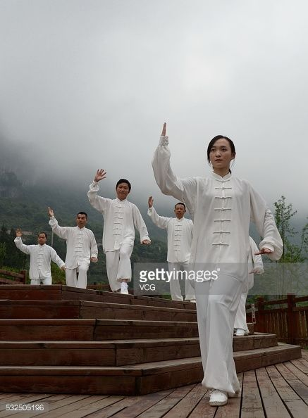 Tai Chi enthusiasts perform Tai Chi at a scenic resort on May 18 2016 in Zunyi Guizhou Province of China Nearly one thousand Tai Chi performers...