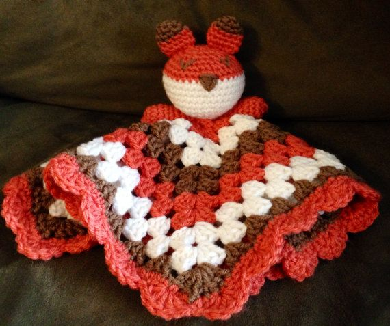 This super cute, gender neutral fox lovey measures 12in x 12in and was made with 100% acrylic yarn. It can be machine-washed (cold water,
