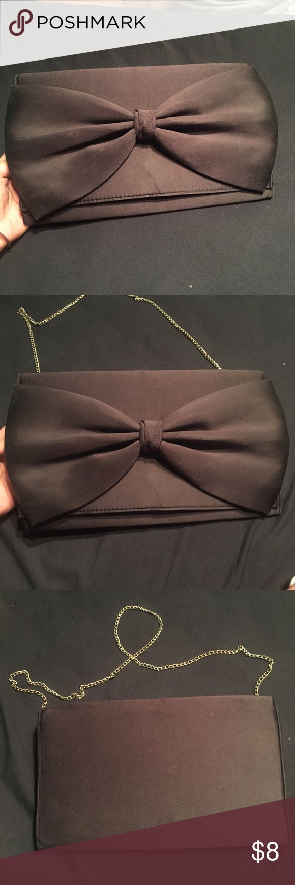 H&M Little Black Bow Purse/Clutch H&M purse that can turn into a clutch. Very chic, has been worn a handful of time. Has metal chain that can hide inside, 1 zipped pocket on inside. Has slight stain. H&M Bags