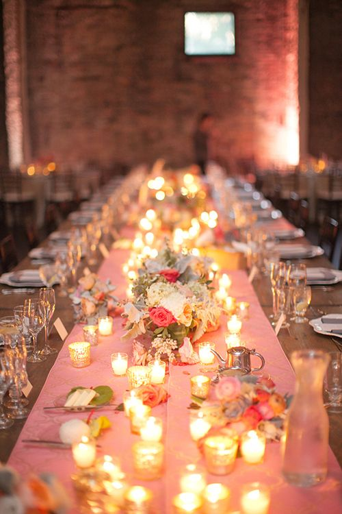 Farm tables with pink runners and garden roses are perfect for a late-summer wedding   @lauraivanova   Brides.com