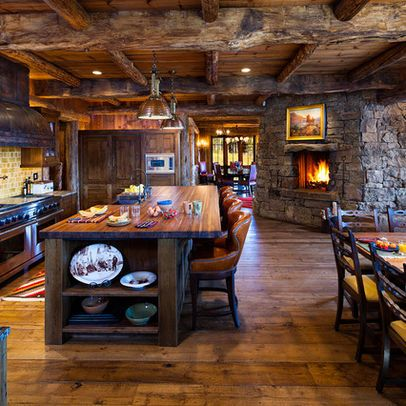 Rustic French Country Kitchen. Cabinets, hardwood flooring, ceiling paneling.