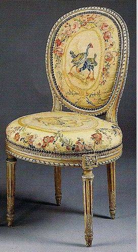 A pair of Louis XVI painted and parcel-gilt chaises en cabriolet, last quarter 18th century, upholstered in contemporary tapestry. Bearing the stamp, G. Iacob.