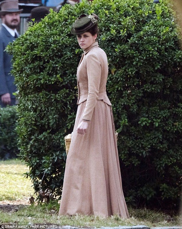 Formality: Her third costume for the day was peach and elegantly arranged...