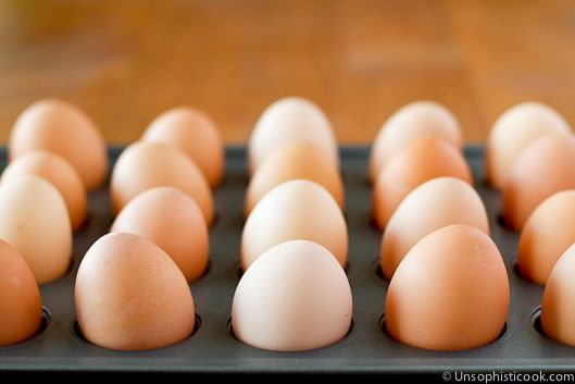 """TIP!!!! Just in time for EASTER!  Easy Hard """"Boiled"""" Eggs! -   Bake at 325 for 30 minutes. Remove with Chef's Tongs and place in an ice bath immediately.  When I do this many eggs I just fill the sink with ice water and place them right in there. Eggs are SO EASY to peel, no sticking!     **Tip: Place them on their side on a mini muffin pan (on their side so the yolks stay in the middle)...mini muffin pan so they don't roll all over"""