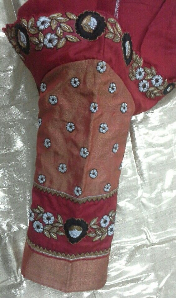 Ikat pattu blouse with elbow length hand with thread and zari work 7702919644