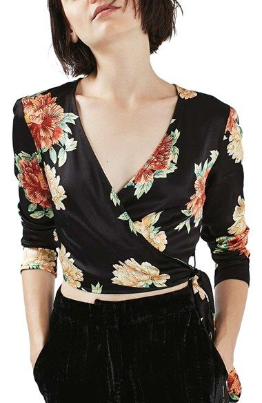 Free shipping and returns on Topshop Sophia Floral Satin Wrap Top at Nordstrom.com. Pretty flowers bloom atop a beautiful wrap blouse that ties in a playful bow at the barely cropped hem.