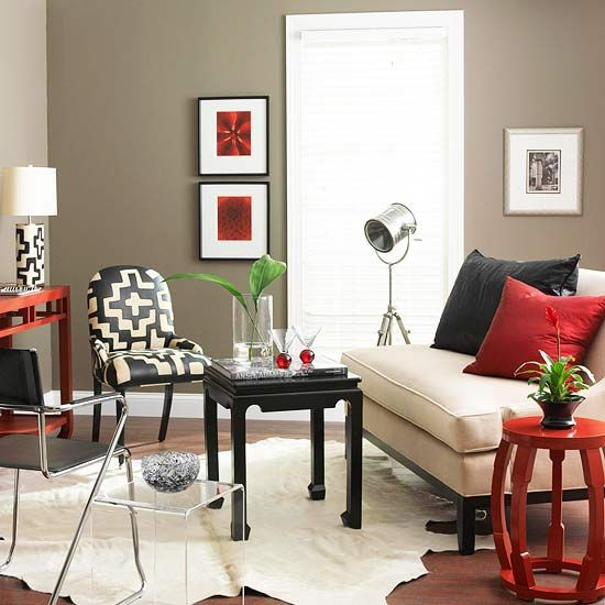 I first saw this room about a month ago, and I haven't been able to stop thinking about it since. The wall color with the neutral furnishings, red and black accents is unusual and really, really works. I keep going back and forth with whether I want that in my bedroom or my living room. I just know I want it.
